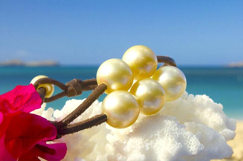 Bracelet 5 perles dorées d'Australie