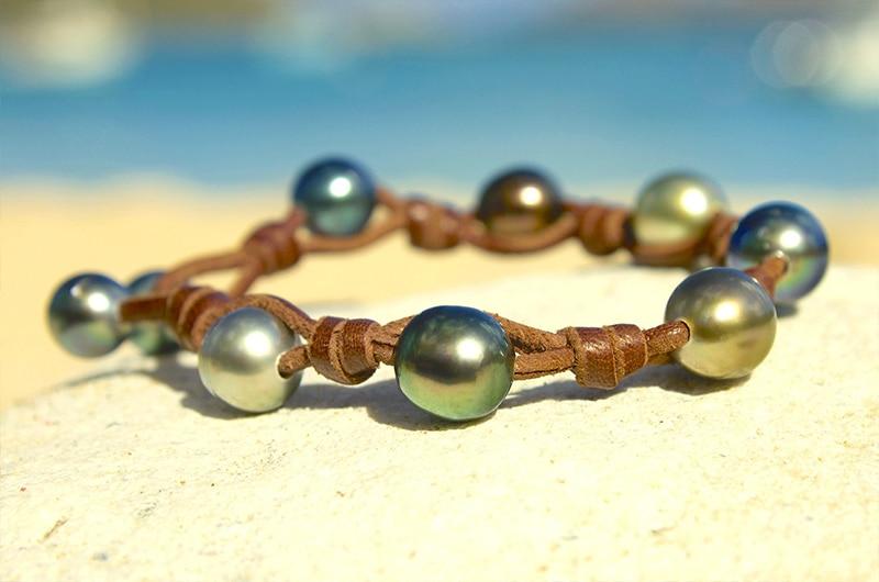 Bracelet 9 perles de Tahiti et noeuds