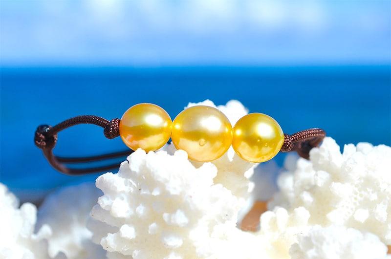Bracelet ajustable 3 perles d'Australie - 8.5mm